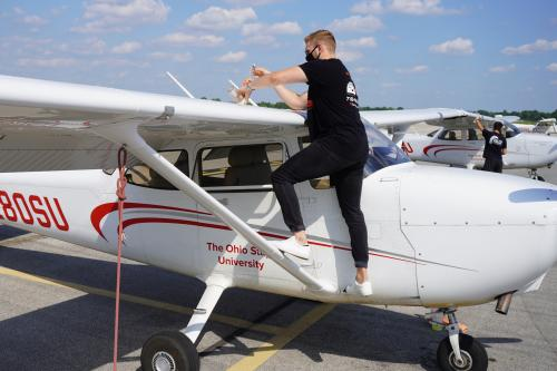 Image of training aircraft preparation and cleaning