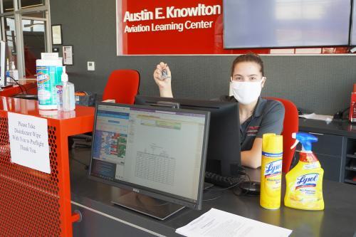 Image of student worker at flight education dispatch desk