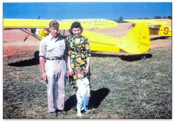 Image of Harley Snook and family in front of Piper Cub